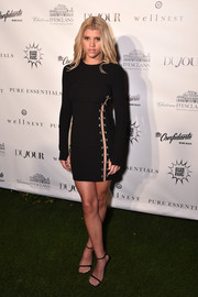 Sofia Richie rocked a fitted black Versus Versace dress with a slashed side at the Art Basel kickoff.