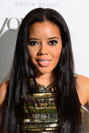 Angela Simmons left her long, straight hair loose with a center part for the DuJour Magazine event honoring Marc Quinn.