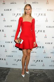 Karolina Kurkova looked feminine and futuristic in a red fit-and-flare mini dress by David Koma at the DuJour Magazine event honoring Marc Quinn.