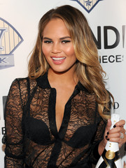 Chrissy Teigen attended the DuJour Magazine party wearing her hair in lovely, lush waves.