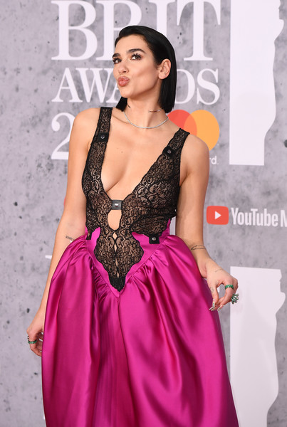 Dua Lipa Gemstone Ring [fashion model,clothing,dress,shoulder,pink,gown,formal wear,fashion,a-line,neck,red carpet arrivals,brit awards,london,england,the o2 arena,dua lipa]