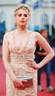 Lucy Boynton paired a quilted gold Miu Miu clutch with an embellished nude dress for the Deauville American Film Festival premiere of 'In Dubious Battle.'