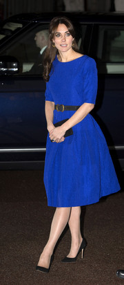 Kate Middleton looked elegant in a three-quarter sleeved blue midi dress with a black belt and matching pointed heels.