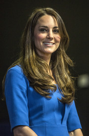 Kate Middleton left her hair loose with a side part and feathered ends when she attended the ICAP Art Room opening.