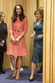 Kate Middleton paired her top with a matching pleated A-line skirt.