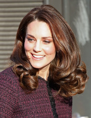 Kate Middleton looked perfectly sweet with her curly 'do while attending the Magic Mums Christmas party.
