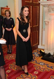 Kate Middleton looked supremely elegant in a tea-length black Preen dress with an asymmetrical neckline at the Place2Be Wellbeing in Schools Awards.