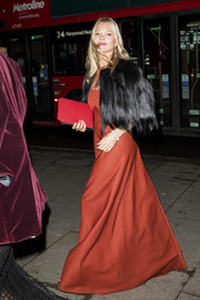 Kate Moss headed to the 2019 Portrait Gala wearing a burnt-orange gown.