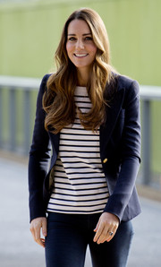 Kate Middleton attended a Sportaid Athlete Workshop looking smart in a black-and-white striped Ralph Lauren top and a navy blazer.
