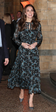 Kate Middleton kept it demure in a printed midi dress by L.K.Bennett while attending a tea party in honor of Dippy the dinosaur.
