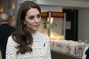 Kate Middleton looked very girly with her side-swept waves at the UK premiere of 'A Street Cat Named Bob.'
