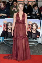 Joanne Froggatt bared some cleavage in a maroon Maria Lucia Hohan halter gown with ruffle detailing at the UK premiere of 'A Street Cat Named Bob.'