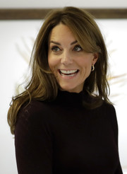 Kate Middleton wore her hair down in a casual-chic style while visiting the Angela Marmont Centre for UK Biodiversity.
