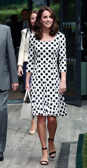 Kate Middleton worked a classic polka-dot print while visiting the All England Lawn Tennis and Croquet Club.