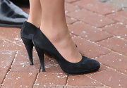 Kate Middleton knows that less is more as she showed here with simple black suede pumps.
