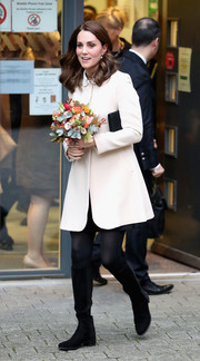 Kate Middleton kept warm with a classic cream swing jacket by Goat while visiting Hornsey Road Children's Centre.