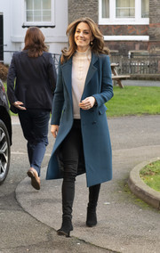 Kate Middleton arrived at the LEYF Stockwell Gardens Nursery & Pre-School wearing a stylish teal coat.