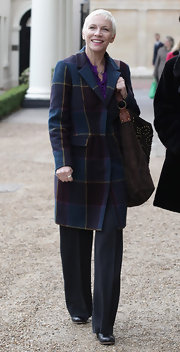 Annie was all smiles in a cozy patterned wool coat.