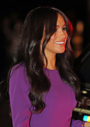 Meghan Markle wore a loose wavy hairstyle at the One Young World Summit opening ceremony.