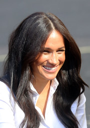 Meghan Markle sported a gently wavy hairstyle at the Smart Works capsule collection launch.