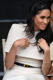 Meghan Markle styled her white dress with a black leather belt by Givenchy for her first official engagement with Queen Elizabeth II.
