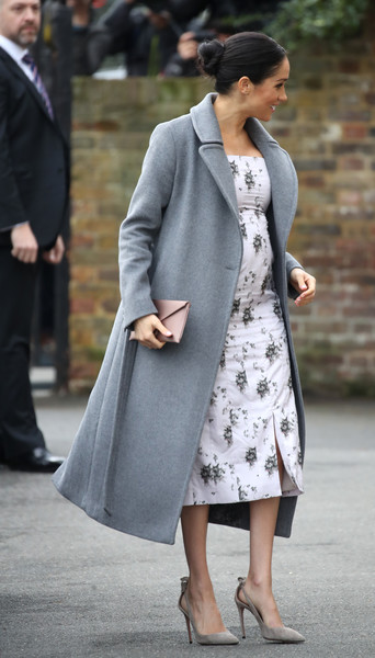 For her footwear, Meghan Markle chose a pair of nude cutout pumps by Aquazzura.