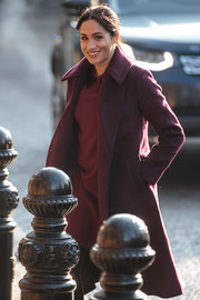 Meghan Markle headed to the Hubb Community Kitchen wearing a stylish plum wool coat by Club Monaco.