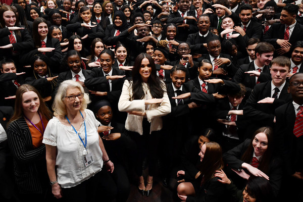 More Pics of Meghan Markle High-Waisted Pants (9 of 30) - Pants & Shorts Lookbook - StyleBistro [people,crowd,audience,event,choir,performance,musical ensemble,team,school children,meghan,sign,dagenham,sussex,duchess,duchess of sussex visits the robert clack upper school,assembly,visit,school assembly,public relations,business school,audience,school,public]