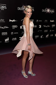 Sarah finished off her soft pink dress with silver ankle strap sandals.