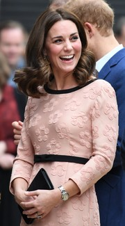 Kate Middleton looked adorable with her retro curls at the Charities Forum event.