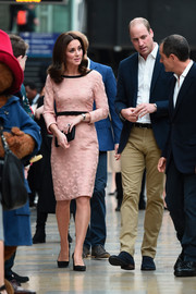 Kate Middleton kept it sweet and ladylike at the Charities Forum event in a pink Orla Kiely midi dress adorned with raised flowers.
