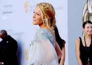 Blake Lively looked breezy and sun-kissed at the BAFTA awards where she complemented her Marchesa gown with a loose updo that featured a side braid.