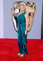 Anna Kournikova looked ravishing at the BAFTA Brits to Watch Event in a vibrant turquoise one-shoulder evening gown. Anna wore her bright blonde locks up in a dramatic 'do and completed her look with silver stilettos.