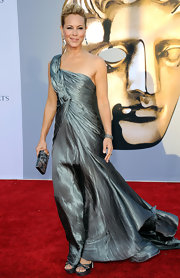 Maria Bello teamed her glamorous asymmetrical gown with matching gunmetal satin heels with a Swarovski crystal platform.