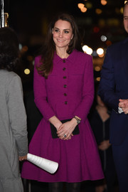 Kate Middleton suited up so elegantly in this purple Oscar de la Renta jacket and flared skirt set for the Guild of Health Writers Conference.