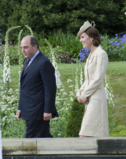 Kate Middleton looked very polished in a champagne-colored brocade coat by Day Birger Et Mikkelsen while attending the Secretary of State for Northern Ireland's garden party.