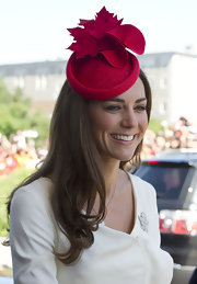 Kate Middleton got in the spirit of Canada day with a bright red fascinator featuring maple leaves.