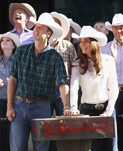 Prince William went country on his Cambridge Canadian Tour in a green and blue plaid button-down shirt.