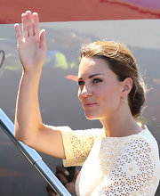 Kate Middleton paired delicate gold dangle earrings with her darling yellow lace dress.