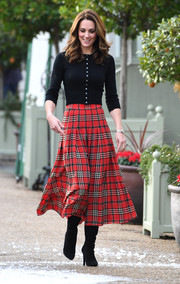 Kate Middleton teamed her top with a red plaid skirt by Emilia Wickstead. Very Christmassy!