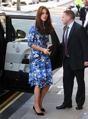 Kate Middleton looked exuberant in a cosmic-print dress by Tabitha Webb while attending the BAFTA charities forum.