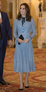 Kate Middleton kept it prim and proper in a periwinkle Temperley London lace dress with black bow detailing at the World Mental Health Day reception.