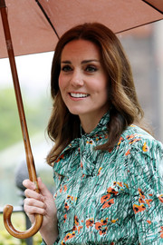 Kate Middleton styled her hair with just a slight wave for her visit to the Sunken Garden at Kensington Palace.