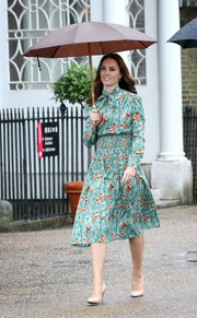 Kate Middleton carried a brown umbrella for some rain protection.