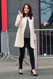 Kate Middleton was casual-chic in black skinny jeans and a cream-colored coat while visiting SportsAid.