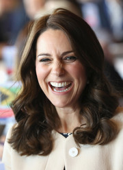 Kate Middleton looked pretty, as always, with her signature shoulder-length curls while visiting SportsAid.