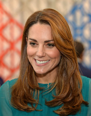 Kate Middleton visited the Aga Khan Centre wearing a loose side-parted hairstyle.