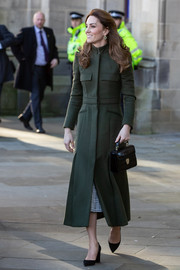 Kate Middleton was military-chic in her green Alexander McQueen coat while visiting Bradford Town Hall.