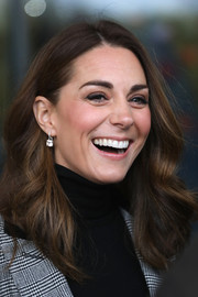 Kate Middleton framed her face with a bouncy wavy 'do for a visit to Basildon Sporting Village.