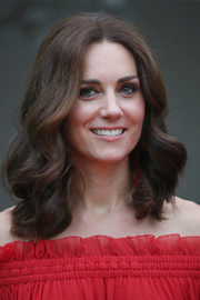 Kate Middleton framed her pretty face with this sweet curly hairstyle for the Queen's birthday party in Berlin.